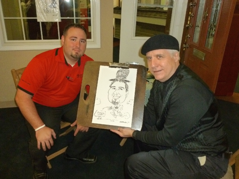 Caricature Artist drawing a Caricature of a man